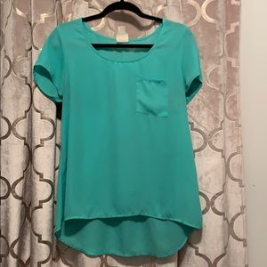 Turquoise blouse. Size M
